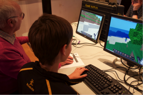 Never to old to play Minecraft! John (70) getting taught how to play Minecraft Pi by Isaac (10)