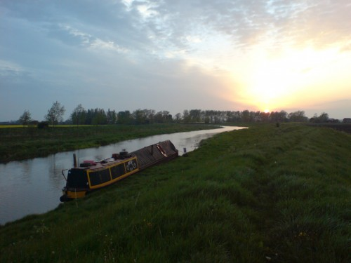 Narrowboat Roe moored on the Old West at sunset