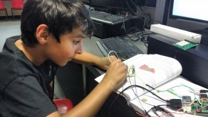 kid with breadboard