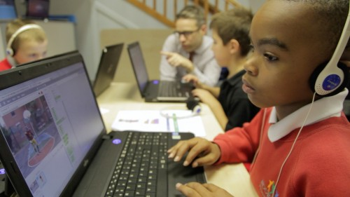 A child absorbed in a task at a Code Club