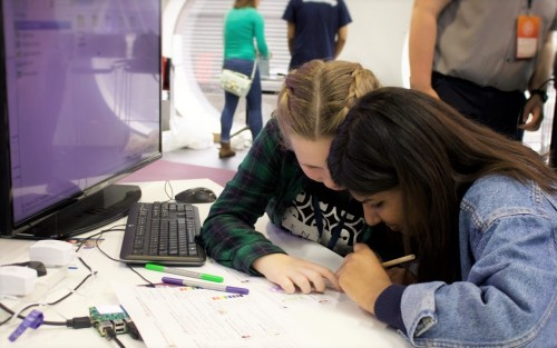 Girls making a pixel pet with a Raspberry Pi and a Sense HAT at MozFest