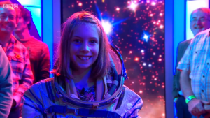 Astro Pi competition winner Hannah Belshaw, wearing an actual space suit