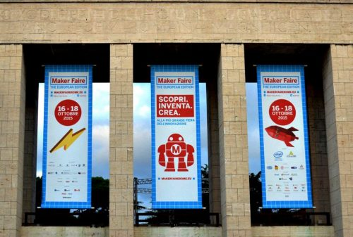 "Banners at the entrance to Maker Faire Rome: ""16-18 Ottobre 2015"" and ""Scopri. Inventa. Crea."""