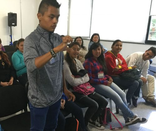 Jorge, a fifteen-year-old student taking part in the HolaMundo training, signs to the class