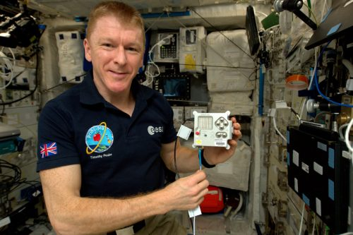 British ESA Astronaut Tim Peake with an Astro Pi unit on the International Space Station
