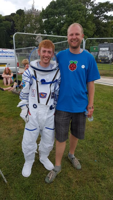 Raspberry Pi's Dan Grammatica, wearing a spacesuit, and Dave Hazeldean