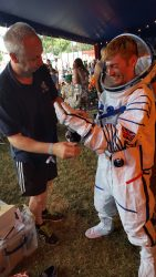 Tony from UK Space helps Raspberry Pi's Dan Grammatica don a spacesuit