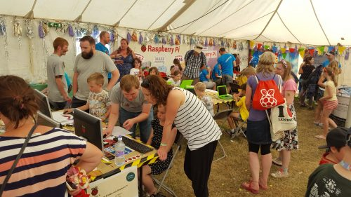 Raspberry Pi staff and volunteers talk to families in the Science Tent