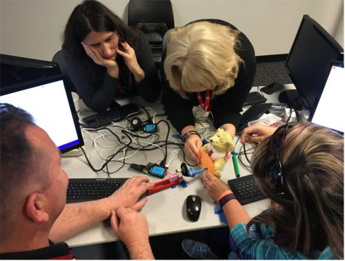 Digital making educators getting hands on with their builds at Picademy