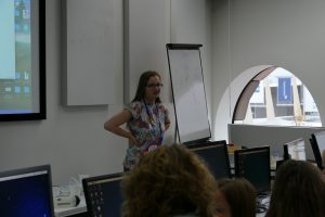 Bethanie Fentiman helps workshop attendees make Jelly Babies burp