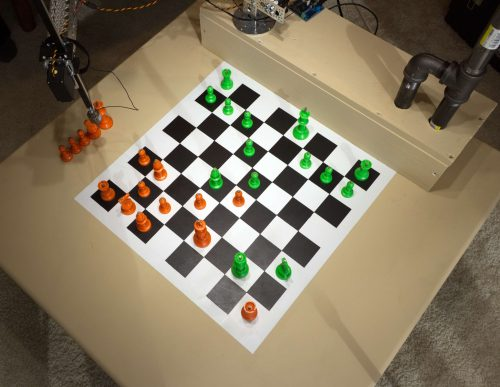 Image of chess board and Raspberry Turk robot