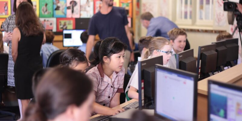 A computing classroom filled with learners
