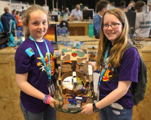 Photo: two girls wearing CoderDojo t-shirts present their Raspberry Pi-based hovercraft at CoderDojo Coolest Projects 2016