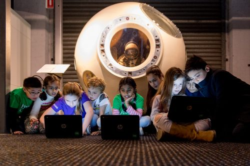Images of children taking part in Code Club Australia's Moonhack 2017
