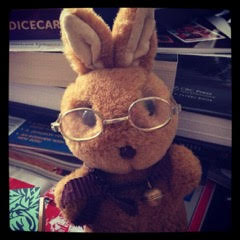 stuffed toy rabbit wearing glasses
