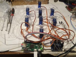 8 servomotors connected to a controller board and a raspberry pi- steampunk tentacle hat by Derek Woodroffe