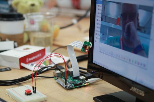 A Raspberry Pi and button attached to a computer display