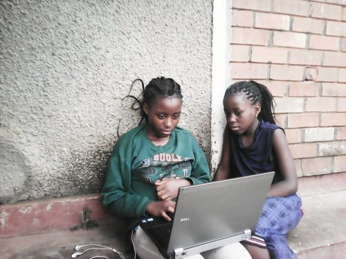 Two girls at a laptop. Joel Bayubasire CoderDojo — 2000 Dojos