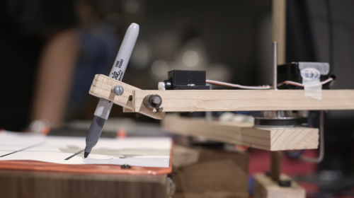 Wooden robotic arm playing tic-tac-toe — Toby Goebeler Tic-Tac-Toe arm Raspberry Pi