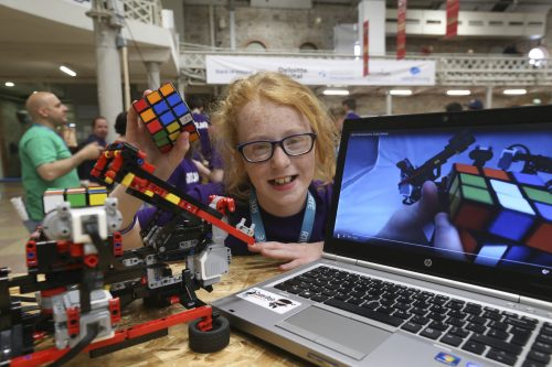 A child presenting a physical computing project