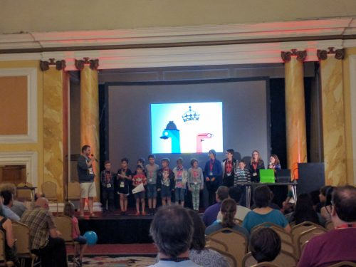 Kids on a stage at PyCon UK