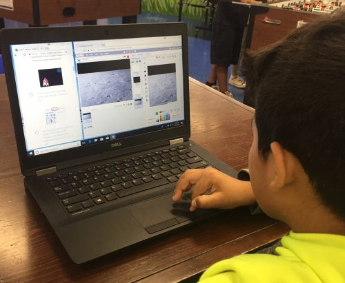 A boy at a laptop coding in Scratch — Boys & Girls Club