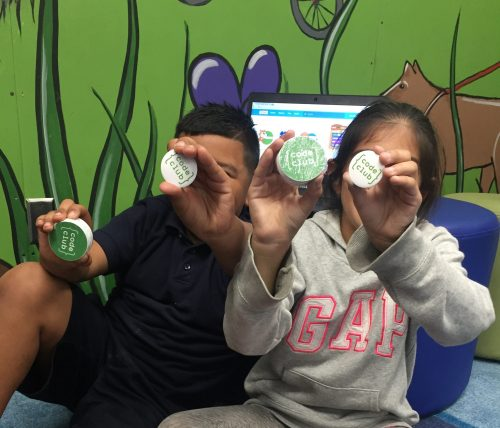Two children holding up Code Club stickers — Boys & Girls Club