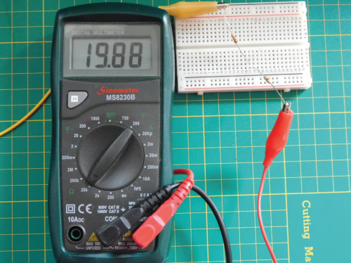 A multimeter showing the figure 19.88 with a resistor connected via crocodile clips