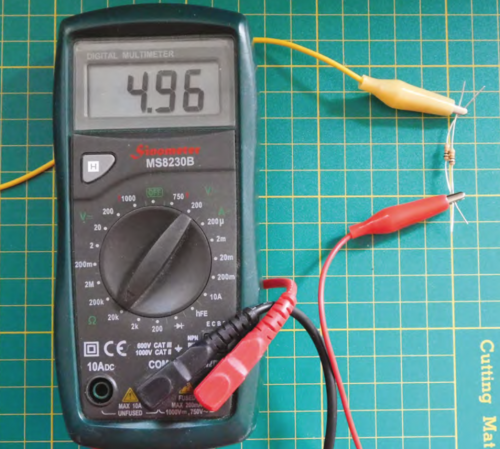 A multimeter showing the figure 4.96 with a resistor connected via crocodile clips