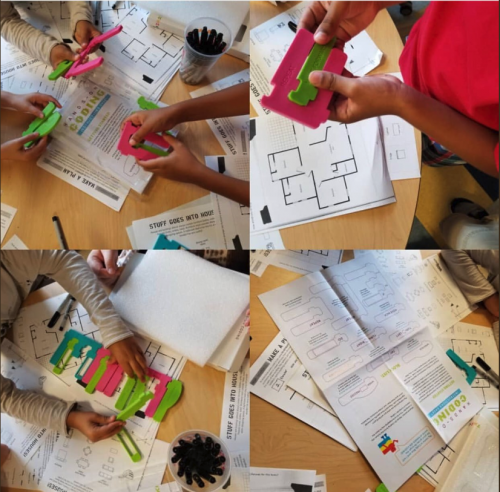 Kids playing with hands-on coding blocks