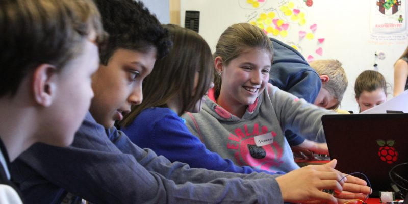 Smiling learners in a computing classroom