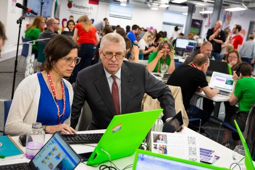 Prince Andrew and a woman watching a computer screen