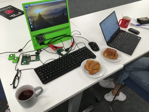 Two computers and two pastries