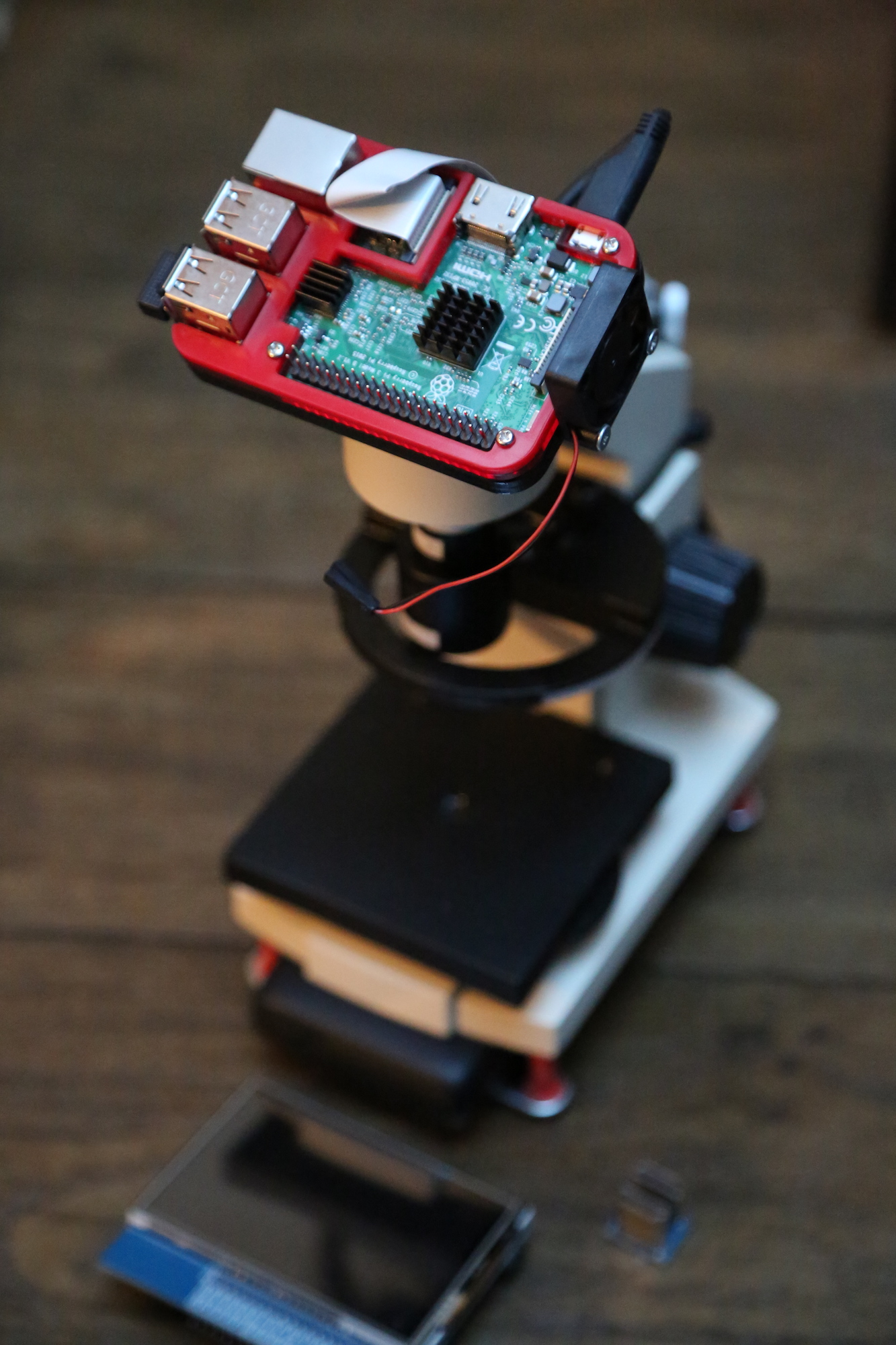 A low-cost, open-source, computer-assisted microscope