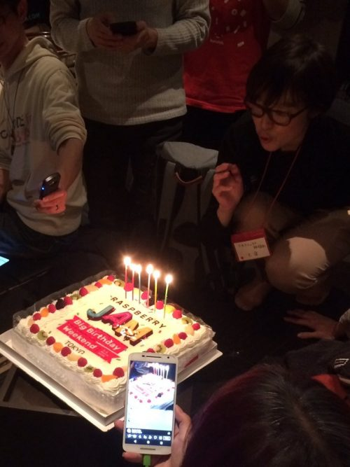 Someone blowing out the candles of a birthday cake