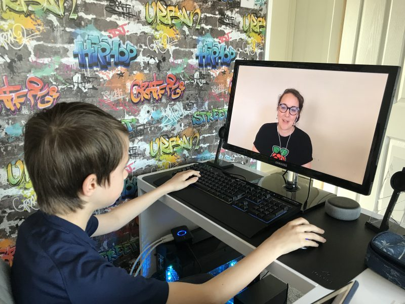 A young person having fun with digital making at home