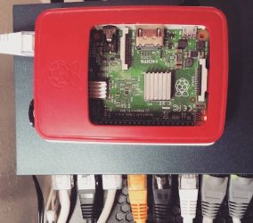 birds eye view of a raspberry pi in a red case