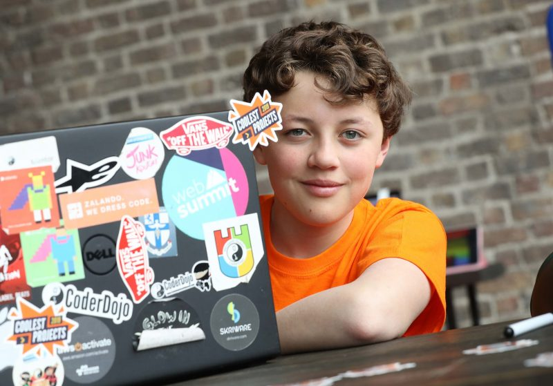 A young person at a laptop