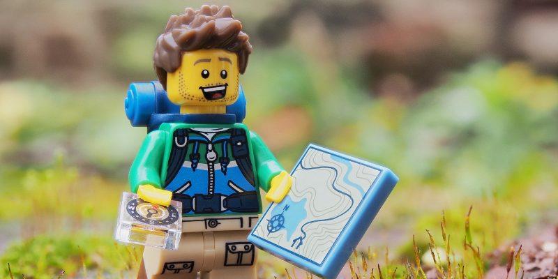 A LEGO figurine in hiking gear