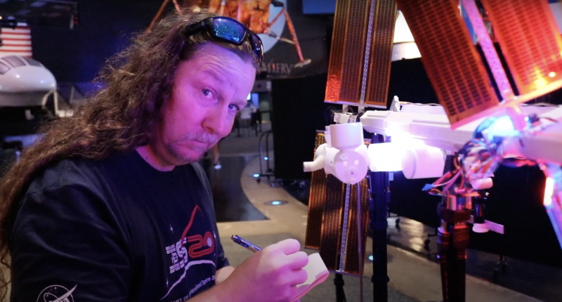 A member of team ISS Mimic raising an eyebrow while working on the ISS Mimic hardware
