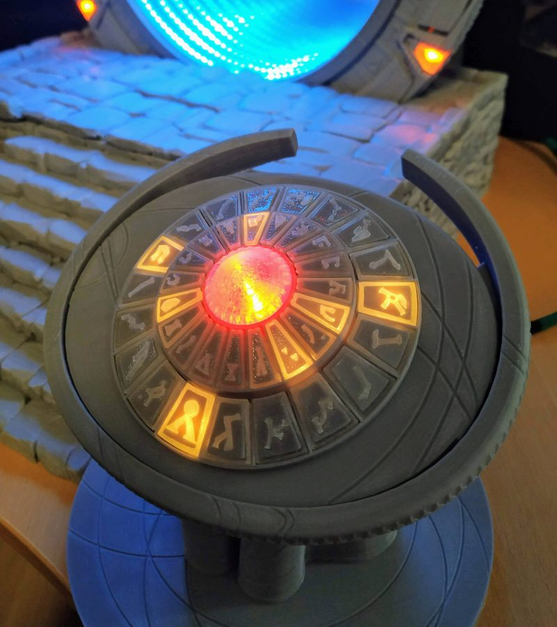 A close up of the stargate control panel with glowing orange touch buttons