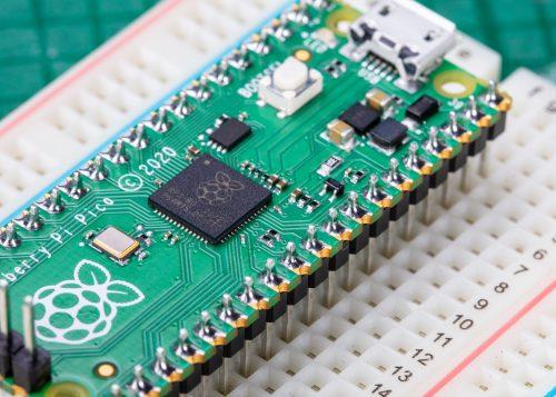A soldered Raspberry Pi Pico on a breadboard.