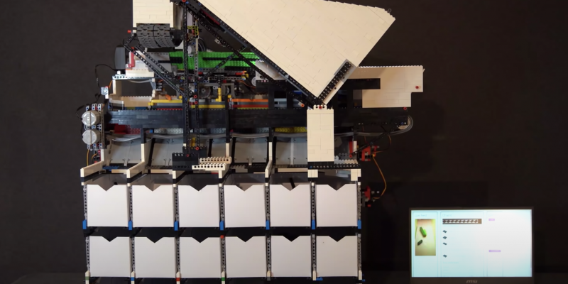 A front view of the LEGO sorter with the sorting boxes visible underneath