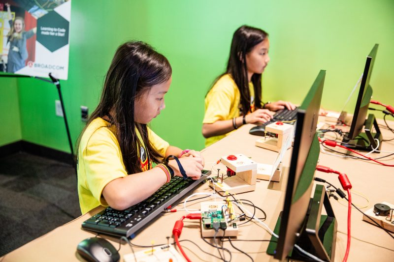 Two girls doing physical computing with Raspberry Pi