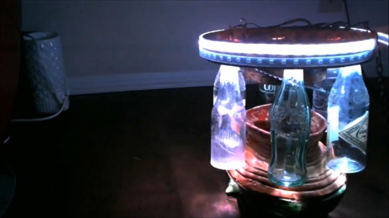 A MonthOfMaking project: a homemade chandelier consisting of glass bottles and an LED ring