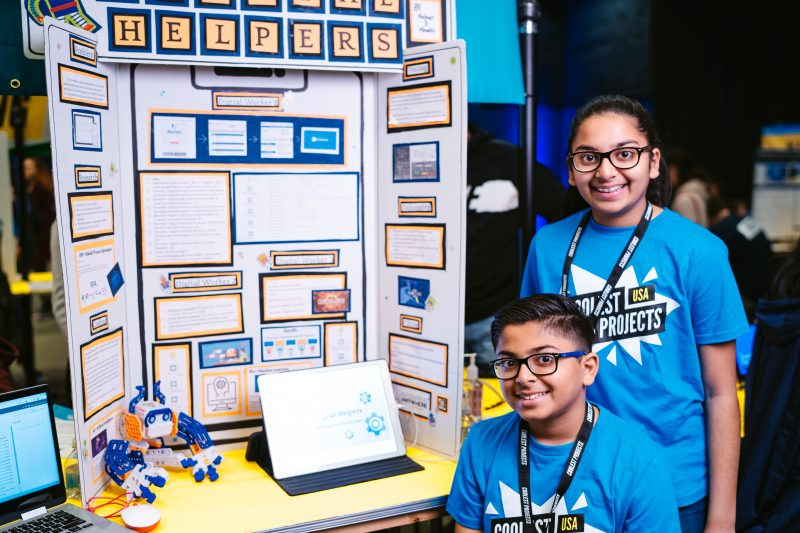 Two siblings presenting their digital making project at a Coolest Projects showcase