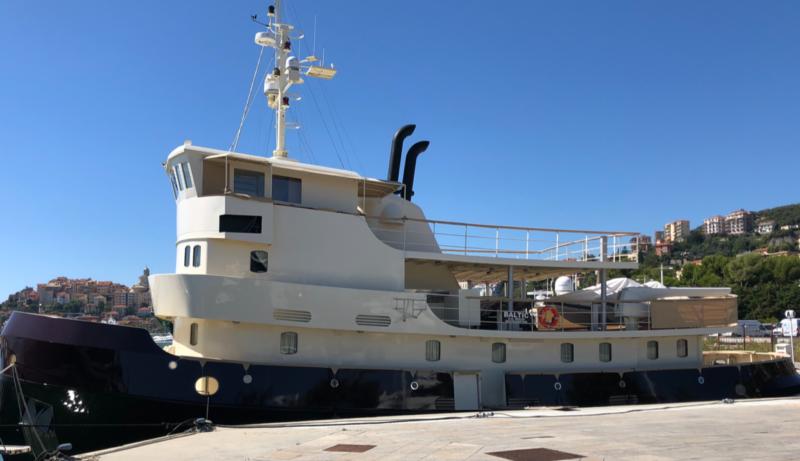 restored boat docked in sunny blue sky location