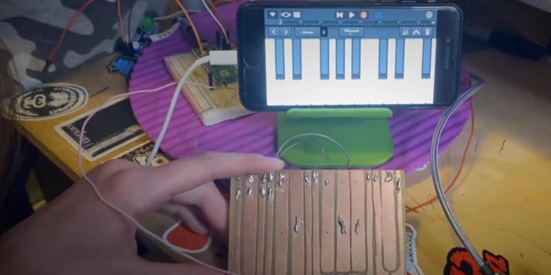 pico piano in front of a phone playing a piano