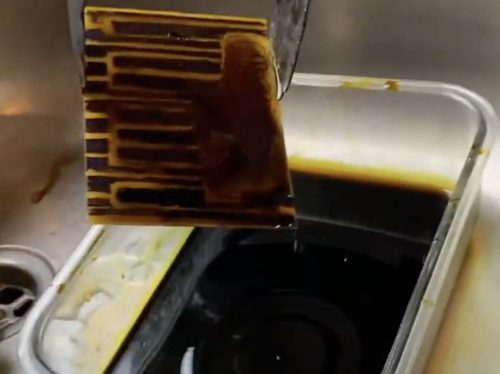 piano coming out of black liquid