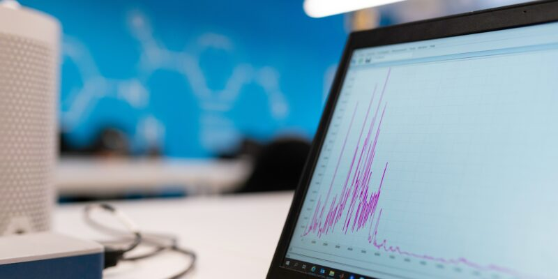 A laptop screen showing a line graph.